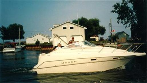 Well maintained cruiser with two tops,head,microwave,forward and mid