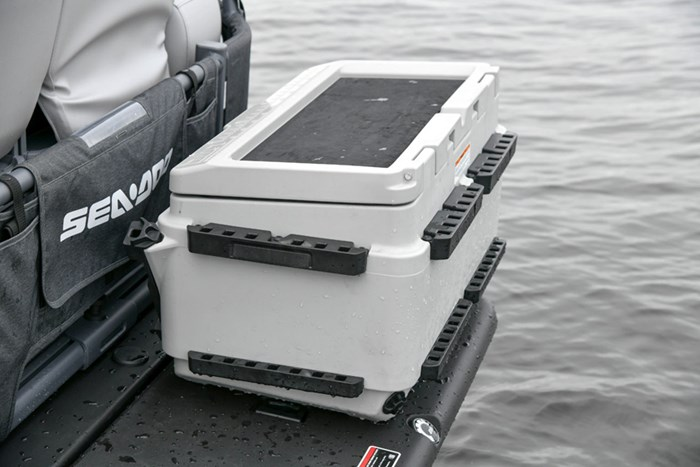 Removable cooler mounts to the swim platform to preserve deck space