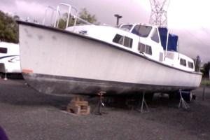 "1984 1984 40' x 12' x 3'6"" Willard Fiberglass Crew Boat/Cruiser c/w Cradle"