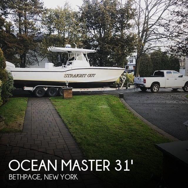 2002 Ocean Master 31 Super Center Console Photo 1 sur 21